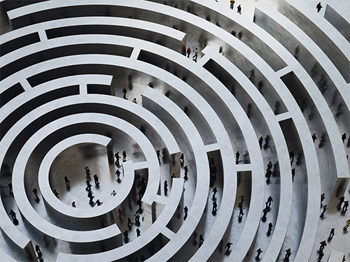People walk in a complicated circular maze